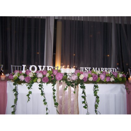 Love garland - Wonderful garland of lila peony, white and purple roses, santini, ivy and candlesfor the bridal table!