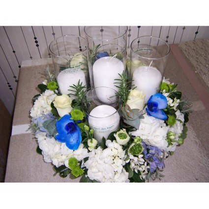Blue Candles - Candles & glasses in a round flower arrengement made of white hydrangeas, ornithogalum, santini and blue orchids!