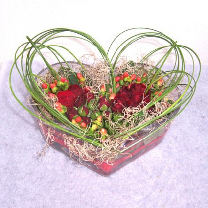Valentine 11 - Flower arrengement with red roses, gerberas, hypericums and various foliage!