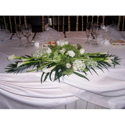 White Beauty - Flower arrengement of impressive white flowers like calles, trachelium, tulips & ornithogalum!