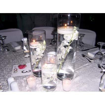 Orchids in water - Cylindrical vases with white orchids in water and floating candles!