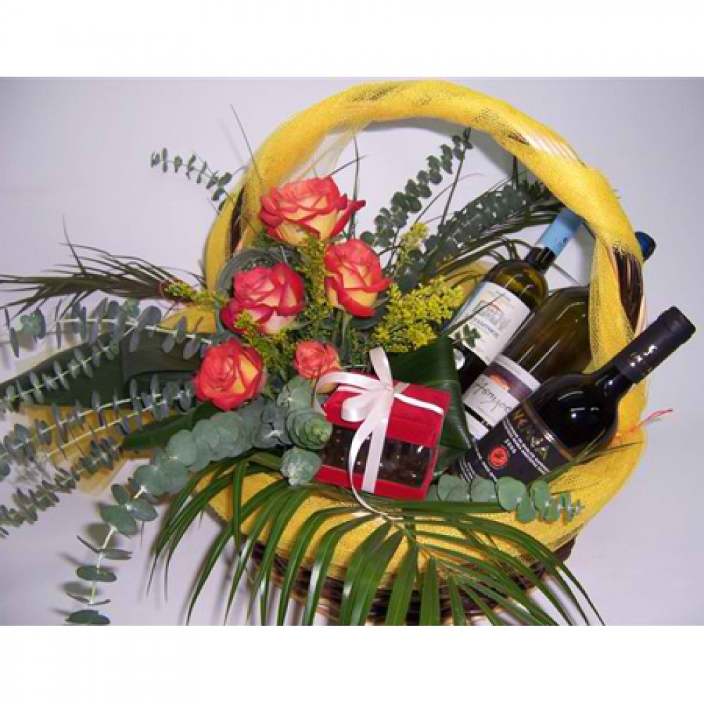 Flower Basket flower arrengement in a basket accompanied by 3 bottles of wine